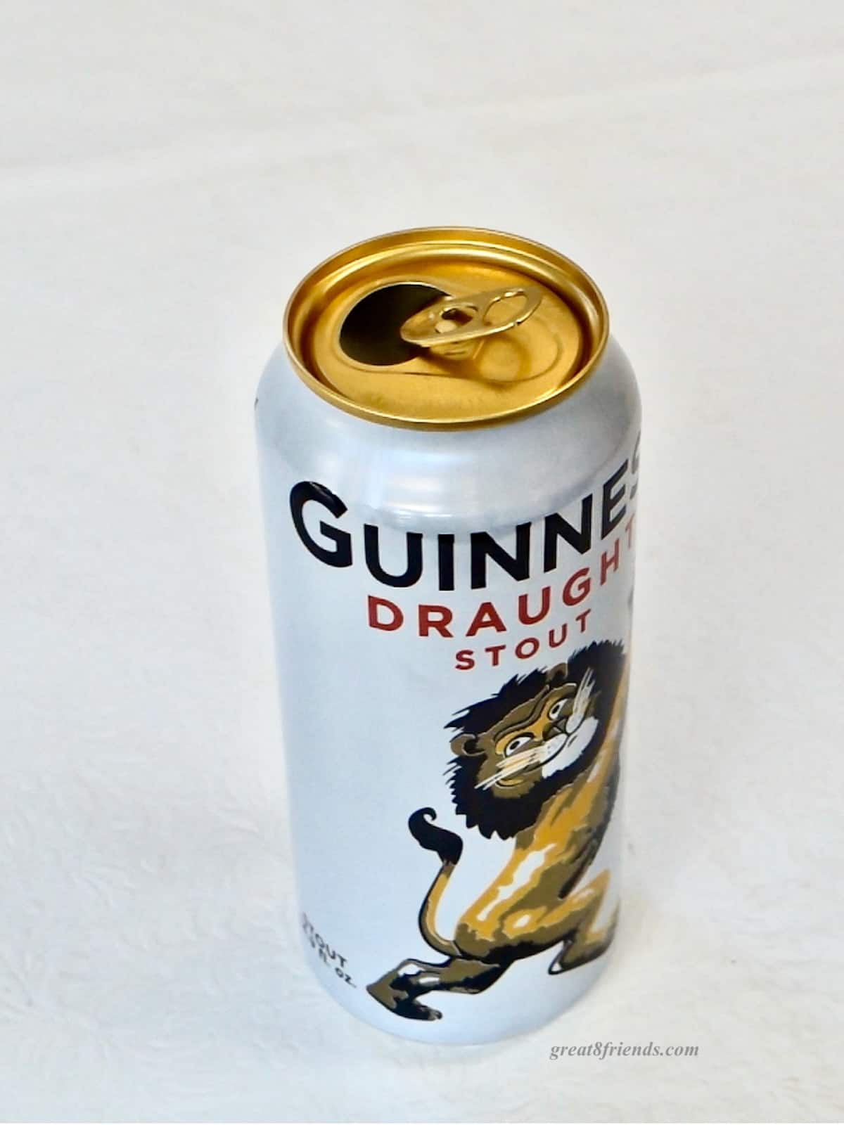 One can of Guinness Draught Stout on a white background.