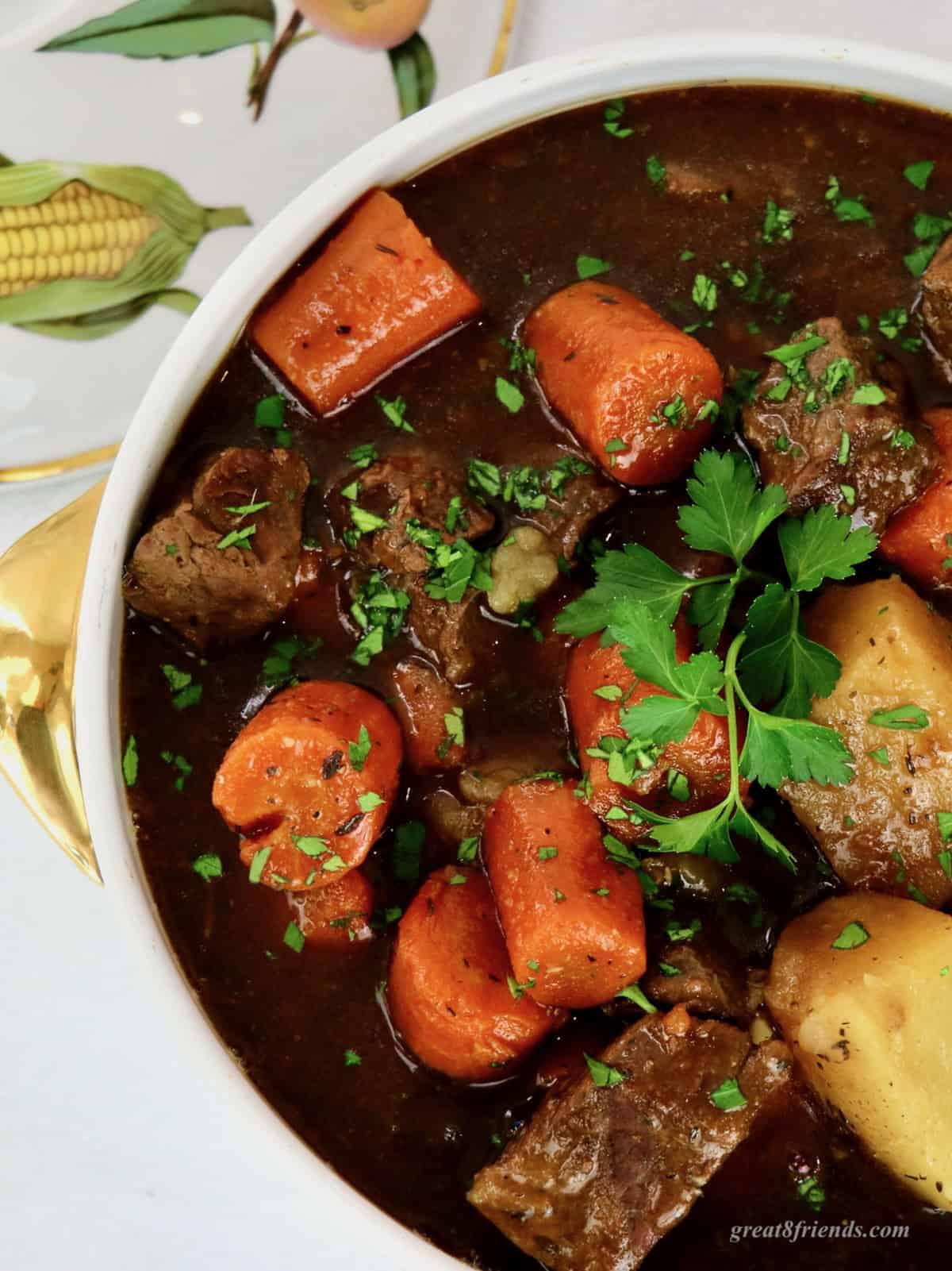Overhead shot of Irish beef stew in a ceramic serving dish.