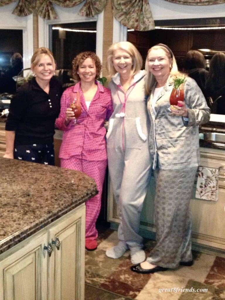 Four women posing in their pajamas.